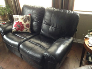 Leather loveseat, very good condition, $125.00