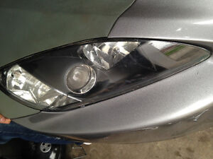 Honda S2000 ap1 headlights with naked corners and hid ballasts