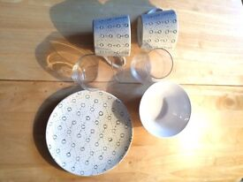 IKEA kitchenware. Two mugs, two glasses, a plate and cereal bowl