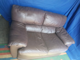 Two seater brown leather sofa (free delivery)