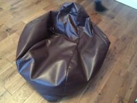 Brown leather bean bag with high back