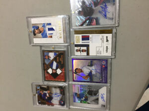 1000's of hockey baseball and some football cards autos jerseys