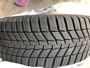 4 like new snow tires with rims from Volkswagen Golf