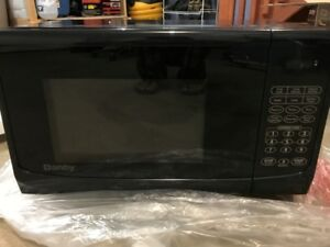 Brand new  Microwave Oven - Never Used .