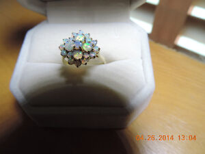 Genuine opal cluster ring in 9kt yellow gold
