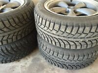 4 studded winter tires with rims