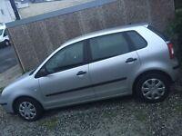 Silver Volkswagen polo 1.4