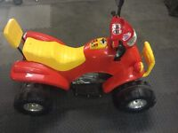 Yellow and red electric quad bike