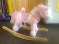 White and pink rocking horse