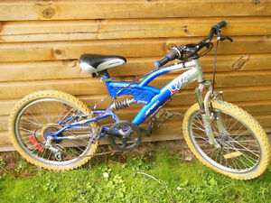 "reduced!! Boy's 20"" 5 speed with shocks"