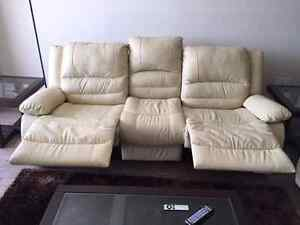 Reclining leather couch and love seat