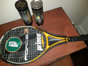 2 tennis rackets with tennis balls
