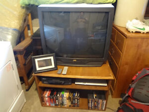 "32"" TV with stand, $40; movies $15/set;  digital frame $3"