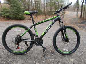 26'' wheels / 21 speed / adult aspen just reduced / brand new