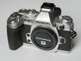 Olympus OM-D E-M1 with grip and kit lens