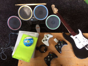Xbox 360, 3 controllers, 20 gb HD, Rockband 2 with guitar/drums
