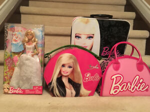 Unopened Barbie and 3 carry bags in great condition!