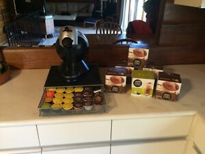 Nescafé Dolce Gusto coffee maker and assorted coffee