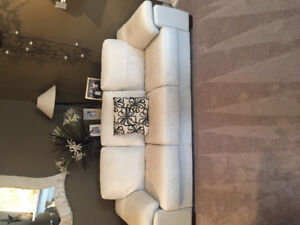Gently used genuine white leather couch and love seat
