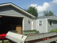 3 bedroom mobile home with 1200 sq ft detached Garage!