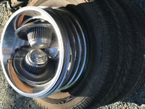 "Trim Rings, centers and 2 tires mounted on 15"" chev rims..."