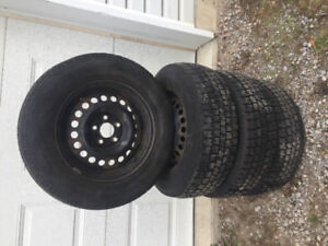 Barely used snow tires - need gone asap!