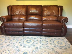 Real Leather. Reclining Studded sofa. Great Condition!