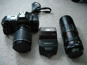 Canon T70 35m camera with flash, zoom lens & telephoto lens