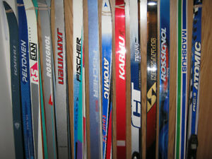 CROSS COUNTRY SKIS-PRO SKI INSTRUCTORS SELLING FAMILY SKIS