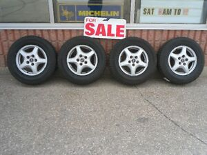 "15"" Pontiac aluminum rims with new tires"