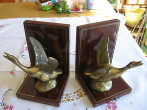 SOLID BRASS BIRD BOOK ENDS .