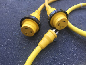 Assorted shore electrical cords and adapters