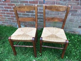 Lovely pair of oak farmhouse dining chairs with rush seats