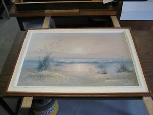 Large framed oil painting of a beach scene