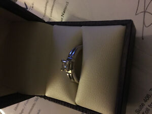 14k white gold princess cut ring. Valued at 1400.00$