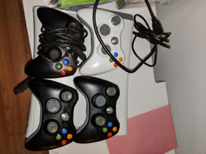 Xbox 360 with 4 remotes and lots of games