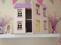 Wooden dolls house with furnirure