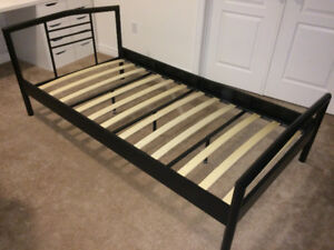 Black metal single bed with planks