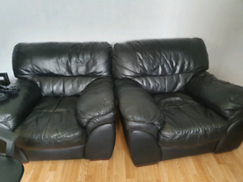 Free two black leather chairs
