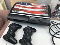 80GB PS3 with games two wireless controllers and wheel