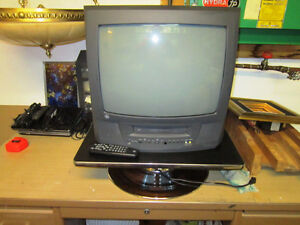 "21"" GE tv (not flat screen) with built-in VCR & Remote"
