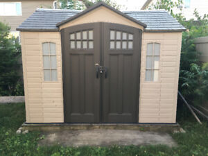LifeTime Shed 8x10 with wood base.