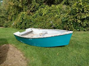 Fibreglass boat and motor