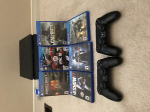 PS4 Mint Condition with games and two controllers