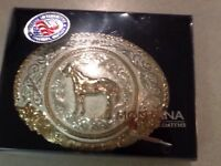 SILVER OVAL BELT BUCKLE FEATURES A HORSE