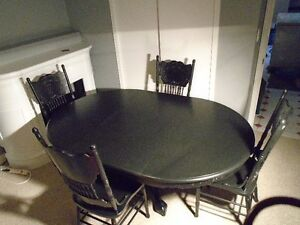Claw-foot pedestal table and 4 press back chairs for sale.