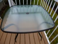 Glass-top patio table for sale