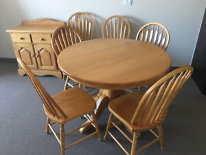 Round oak table, 6 chairs and side cabinet
