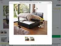 Ottoman bed frame with headboard storage black faux leather.