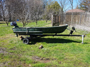 11.5' boat motor and trailer for sale